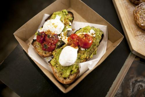 Take away toasted sandwich with avocado, poached egg and tomato