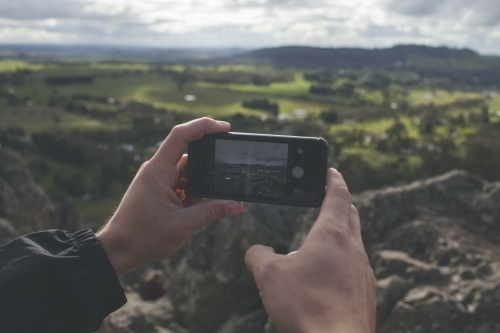 Taking photos of a valley with a smartphone