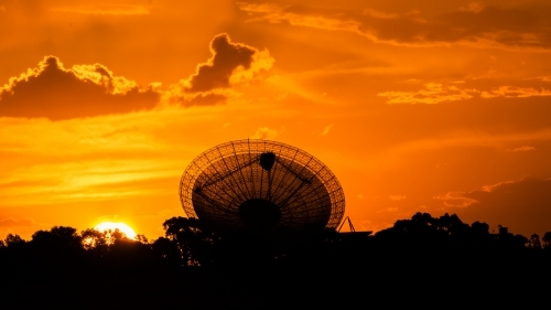 Telescopic Dish against a red fiery sunset sky