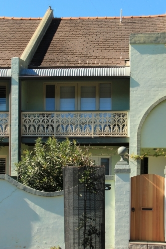 Terrace house with cast iron lace work on verandah