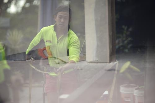 The reflection of a tradesman in the process of building a deck