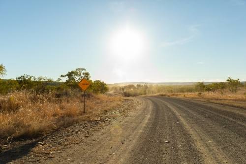 the unsealed Gibb River Road in the Kimberley with floodway sign