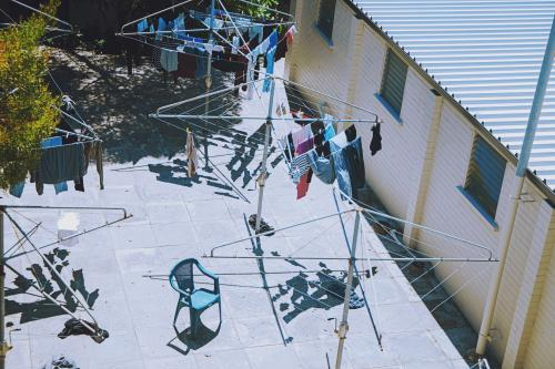 birds eye view of clothes lines and assorted items in public housing