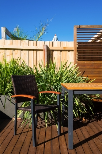 Timber patio area with table and chairs