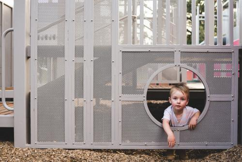 Toddler boy looking at camera from playground