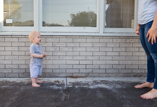 Toddler in a stand off with mum outside home