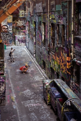 Tourists taking photos of street art in Melbourne Hosier Lane