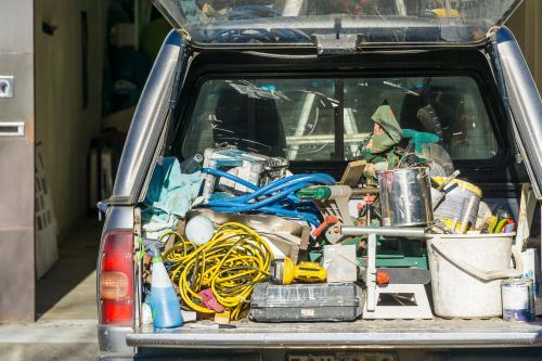 Tradesman's tools and equipment in the back of a car