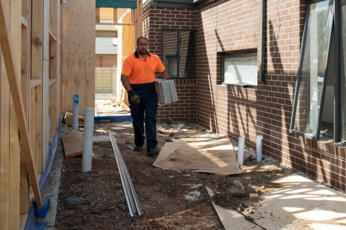 Tradie at work on house building site