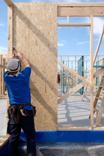 Tradie working on house build site