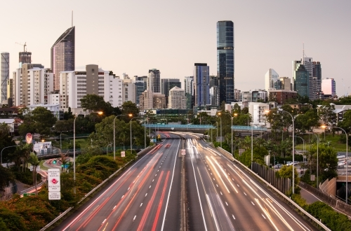 Traffic Streaks and Brisbane City at Sunset