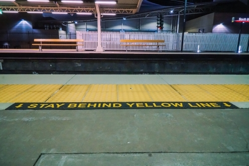 Train station platform yellow line