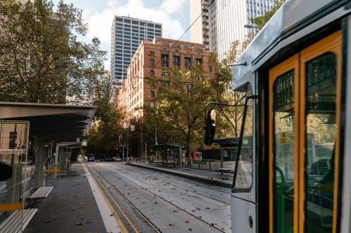 Tram travelling East on Collins St, Melbourne