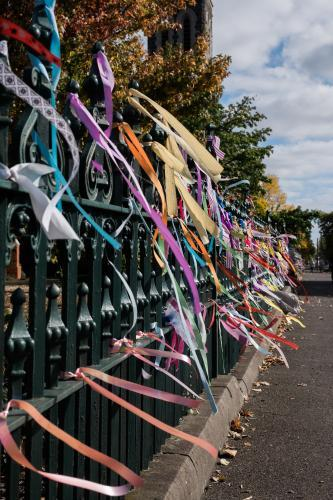 Tribute ribbons left on the fence of a catholic church in support of sex abuse victims