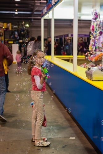 tween girl at royal show with bubble blower