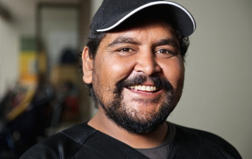 Twenty five Year Old Aboriginal Man Smiling Broadly
