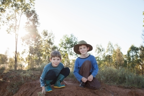 Two happy Aussie kids looking at camera with copy space