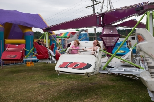 Two girls on an amusement ride at a country show