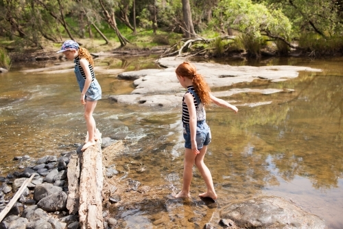 Two girls playing in the river