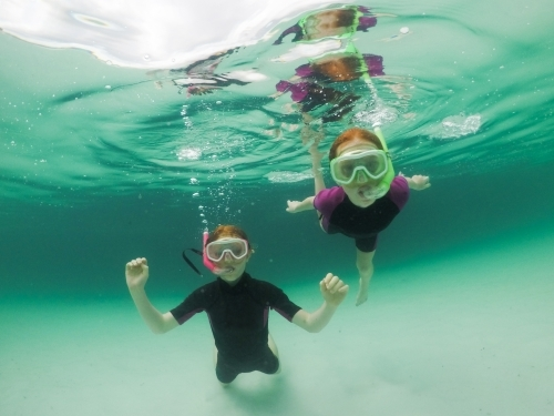 Two girls snorkelling