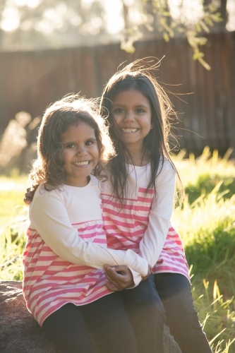 Two happy Aboriginal girl sisters