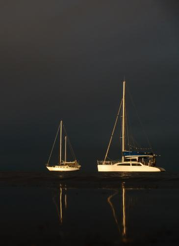 Two Moored Yachts Illuminated by the Setting Sun
