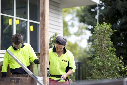 Two tradesmen work on home renovations.