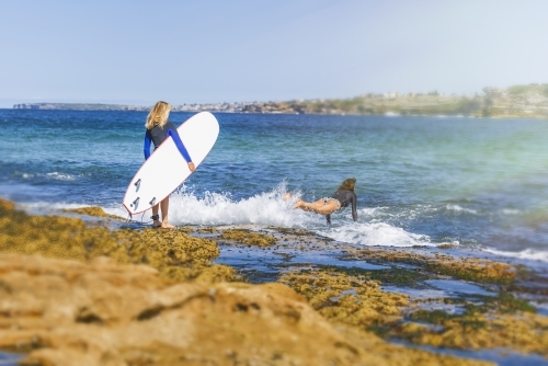 Two women going surfing