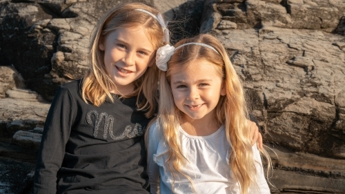 Two young sisters portrait at the beach