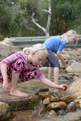 Two Youngs Girls Playing in a Stream