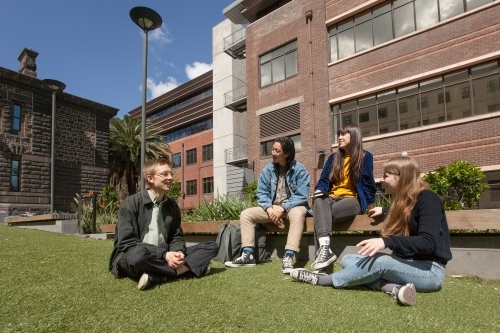Students relaxing on university grounds