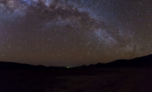 Milky Way arching over remote landscape