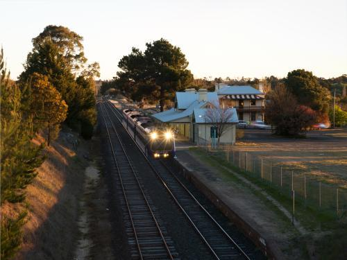 Evening rural train stopped at a railway station