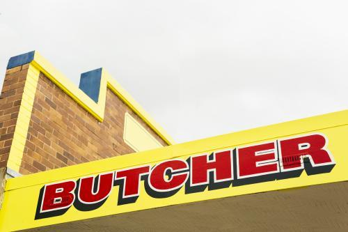 Vibrantly coloured small business butcher sign.