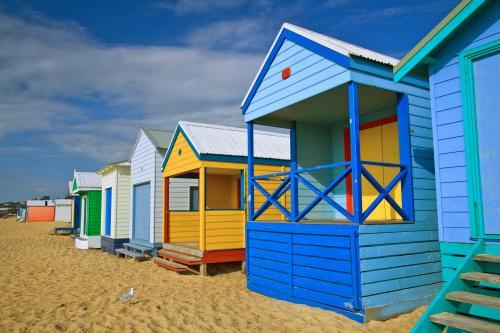 A row of colourful bathing boxes