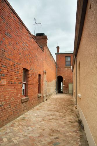 A narrow lane between brick walls