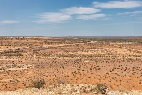 View from Gladstone Scenic Lookout showing road winding through flat,dry expanse