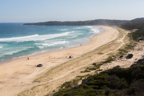 View from Sugar loaf point over lighthouse beach where people are four wheel driving