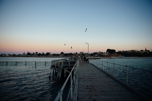 View of Moonta Bay from pier at sunset