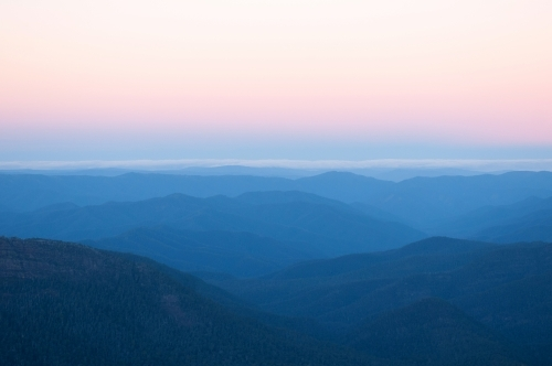 View of mountain ranges at sunset