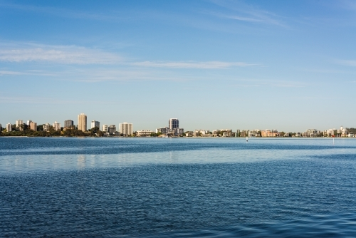 View of South Perth skyline across the tranquil blue Swan River Lake