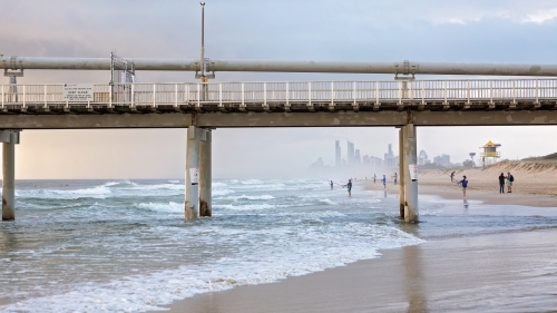 View of surfers paradise through sand pumping jetty at The Spit