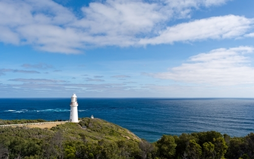 View of the Cape Otway Lighthouse against a ocean and sky backdrop
