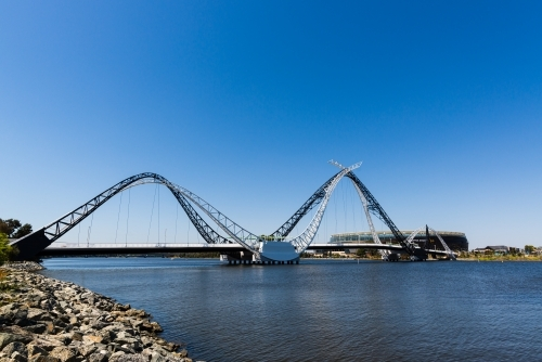 View of the Matagarup Bridge, sports stadium and river with large area of clear blue sky