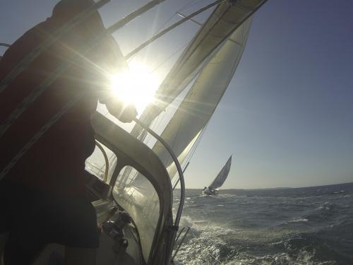 View on board a yacht during a race to the finish