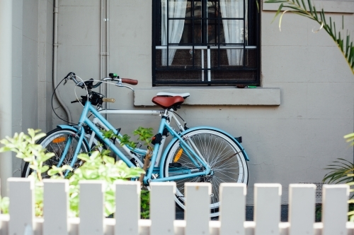 Vintage bikes leaning against home