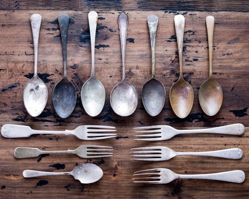 Vintage Cutlery Lay Out On Rustic Wooden Table