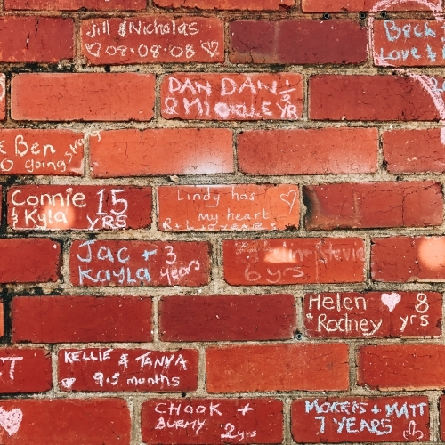 Wall with love messages of same sex couples celebrating Pride Week