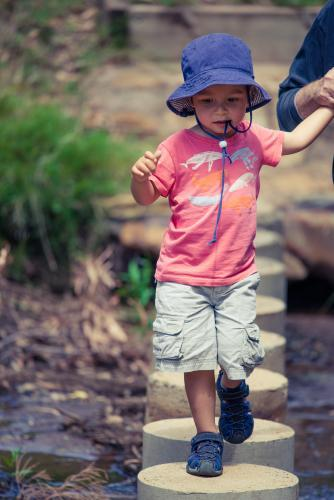 Cute mixed race little boy bushwalking on the Warrumbungles National Park Nature Trail