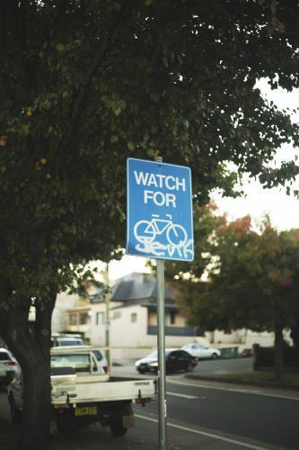 Watching for Bicycles Street Sign
